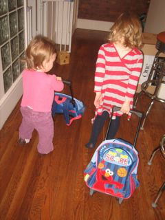 girls-playing-with-elmo-suitcases.jpg
