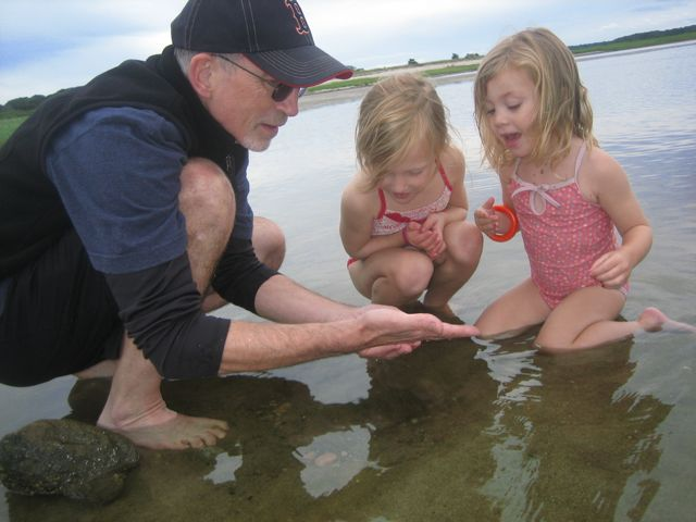 tommy tom with girls in water