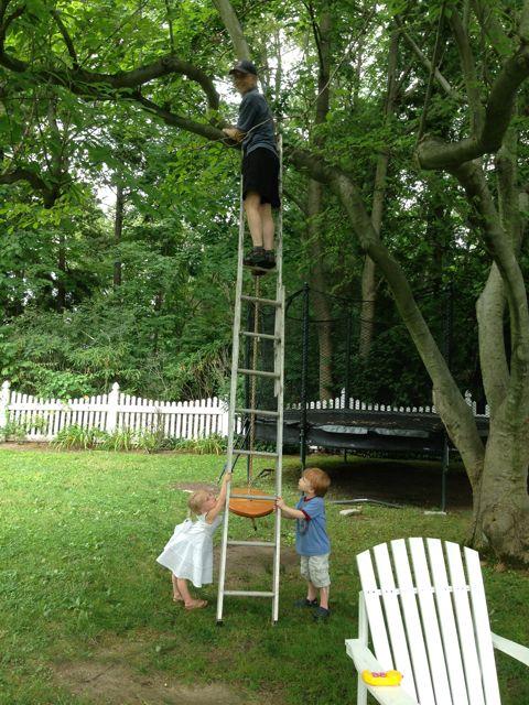 Dad taking down rope swing