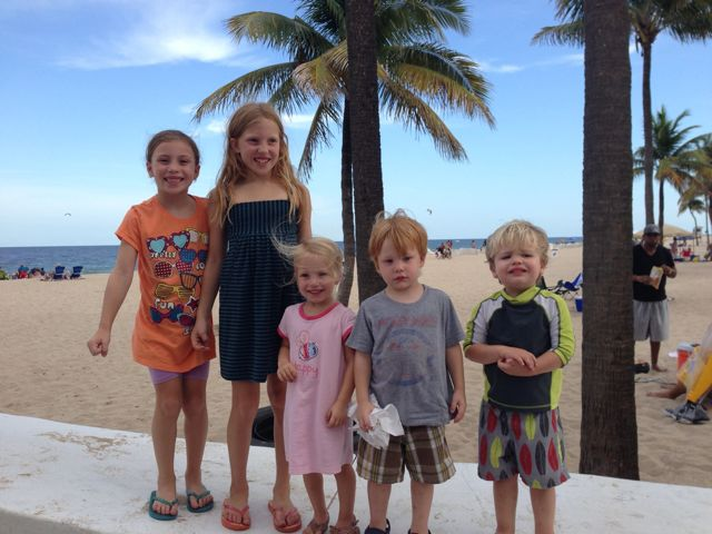 cousins with palm tree backdrop