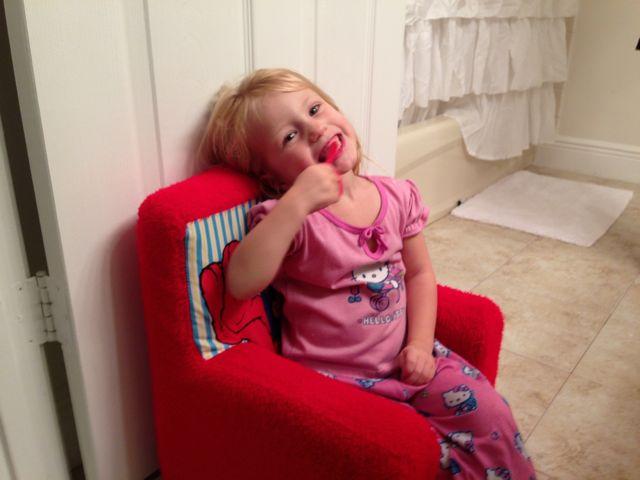 harlowe brushing her teeth