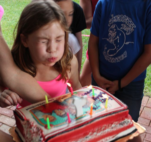 summer blowing out candles