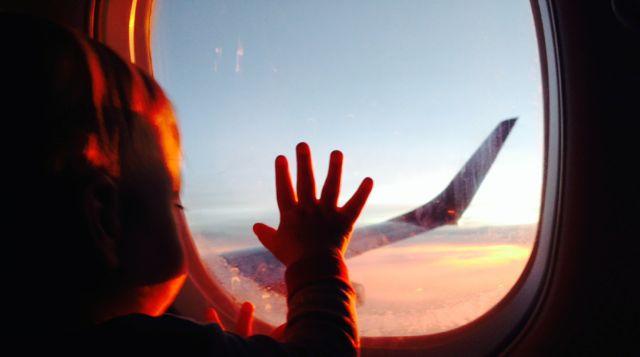 cash on plane at sunset