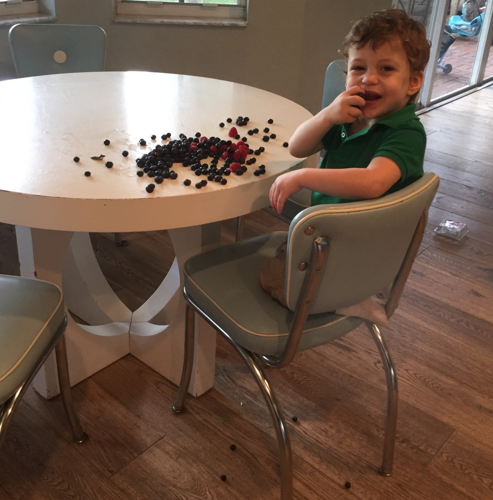 Toddler with berries