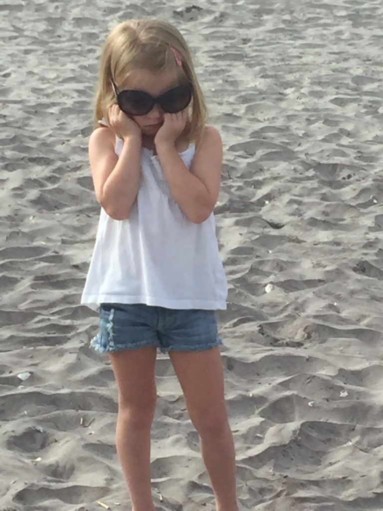 Harlowe sad on the beach