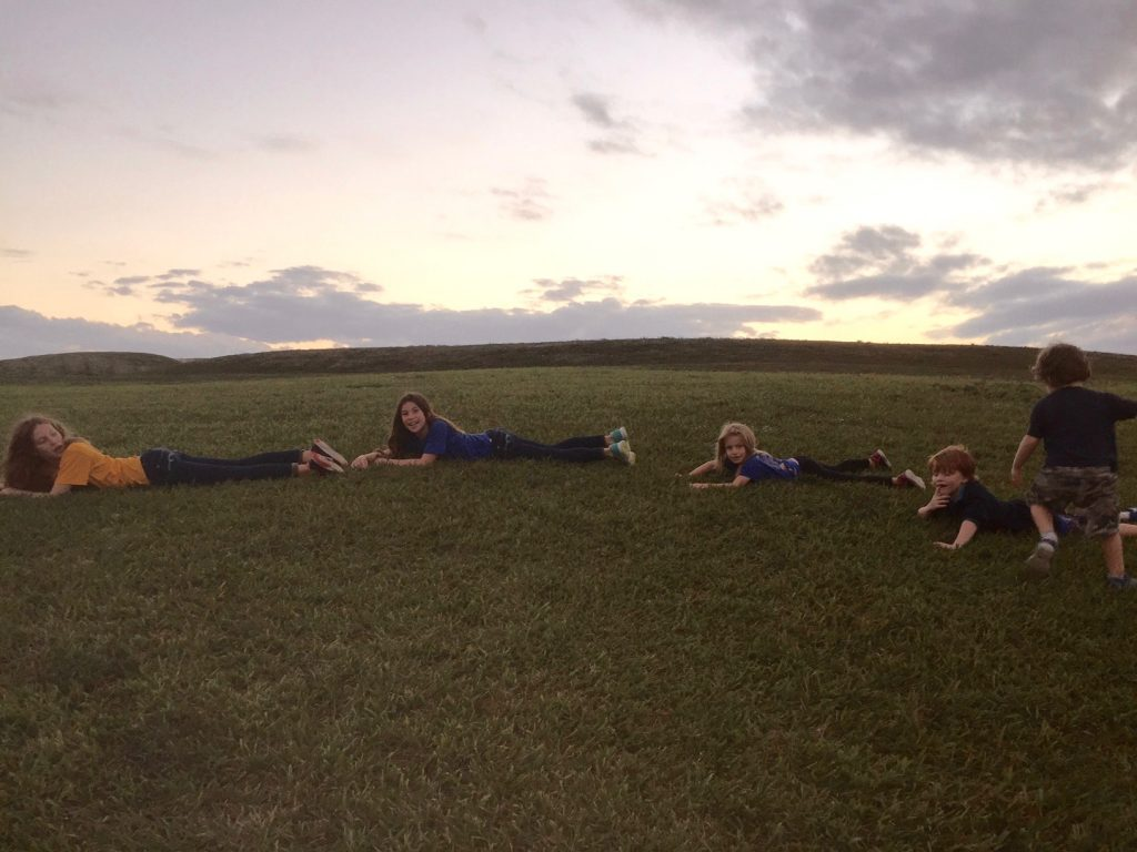 kids-lying-on-the-hill